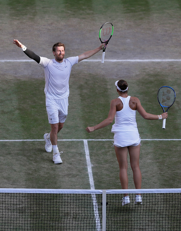 . Nicole Melichar of the United States and Austria\'s Alexander Peya, celebrate winning the mixed doubles final match against Britain\'s Jamie Murray and Victoria Azarenka of Belarus, at the Wimbledon Tennis Championships, in London, Sunday July 15, 2018. (AP Photo/Kirsty Wigglesworth)