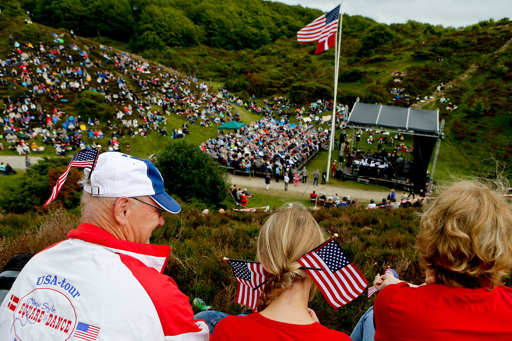 . People participate in the Danish-American Rebild Celebration in Rebild, Denmark, Thursday July 4, 2013. The Rebild organization celebrates American Independence Day each year, and Danes in American still make the trip back to the old country to participate in the festival. (AP Photo/Polfoto, Rene Schutze)