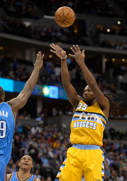 . Denver Nuggets power forward Kenneth Faried (35) takes a shot over Oklahoma City Thunder power forward Serge Ibaka (9) during the first quarter December 17, 2013 at Pepsi Center. (Photo by John Leyba/The Denver Post)