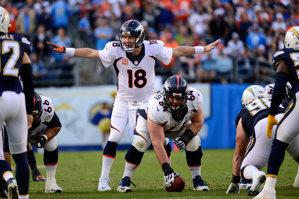 . SAN DIEGO, CA. December 14, - quarterback Peyton Manning #18 of the Denver Broncos in the 2nd half vs the San Diego Chargers at Qualcomm Stadium December 14, 2014 San Diego, CA (Photo By Joe Amon/The Denver Post)