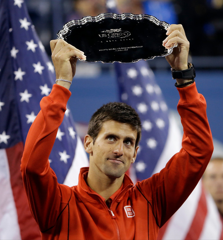 . Novak Djokovic, of Serbia, holds up the second place trophy after losing to Rafael Nadal, of Spain, during the men\'s singles final of the 2013 U.S. Open tennis tournament, Monday, Sept. 9, 2013, in New York. (AP Photo/David Goldman)