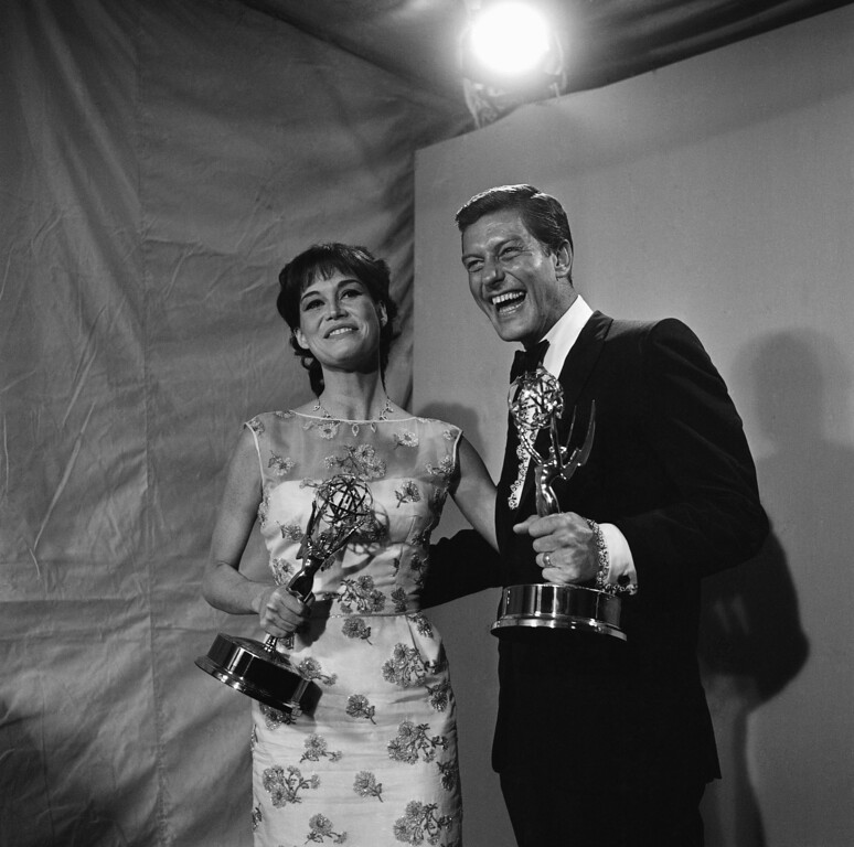 . Dick Van Dyke, right, and Mary Tyler Moore clutch their Emmy Awards after being named the leading actor and actress in a comedy series for their roles in the Dick Van Dyke Show, May 22, 1966, Hollywood, Calif. The show, which ends a long television run this week, crowned its success by scoring four times. (AP Photo)