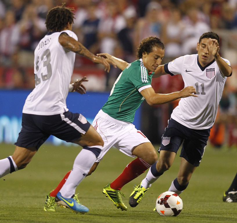 . Andres Guardado (C) of Mexico and Fabian Johnson (23) and Alejandro Bedoya (11) of USA fight for the ball during their Brazil 2014 FIFA World Cup qualifier at Columbus Crew Stadium in Columbus, Ohio, September 10, 2013.  AFP PHOTO / PAUL VERNONPaul VERNON/AFP/Getty Images