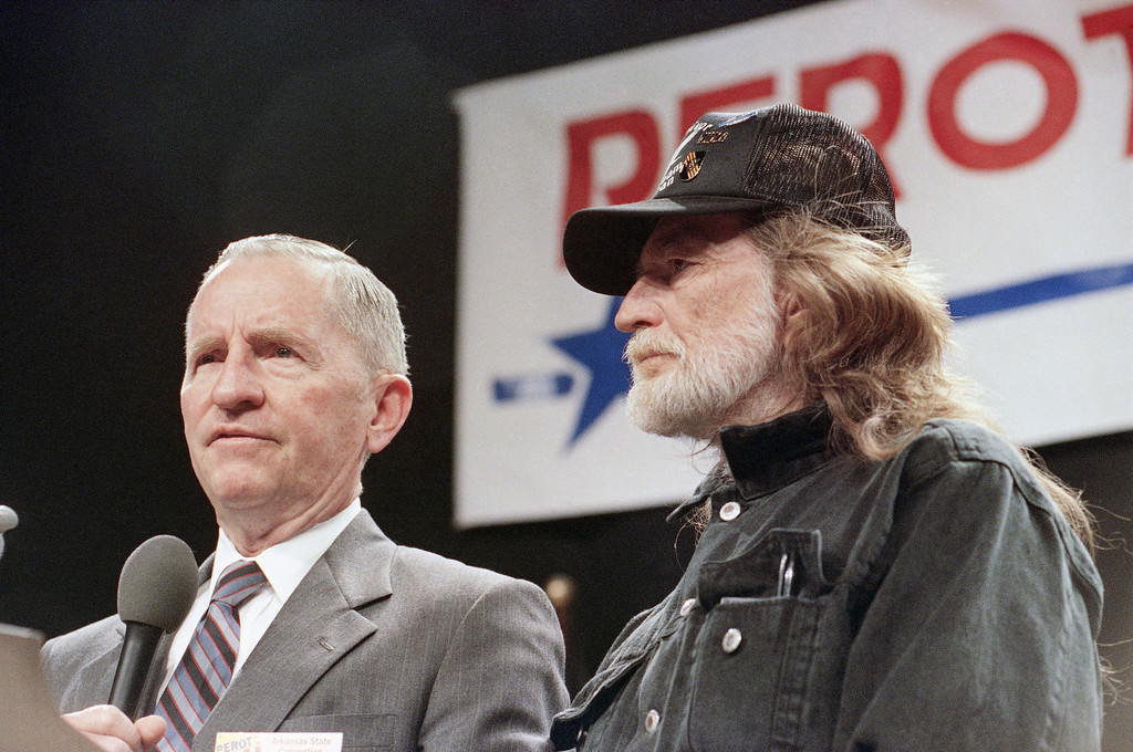 . H. Ross Perot, left, and country singer Willie Nelson share the stage on Saturday, May 30, 1992 at the nominating convention for Perot in Little Rock.  (AP Photo/Danny Johnston)
