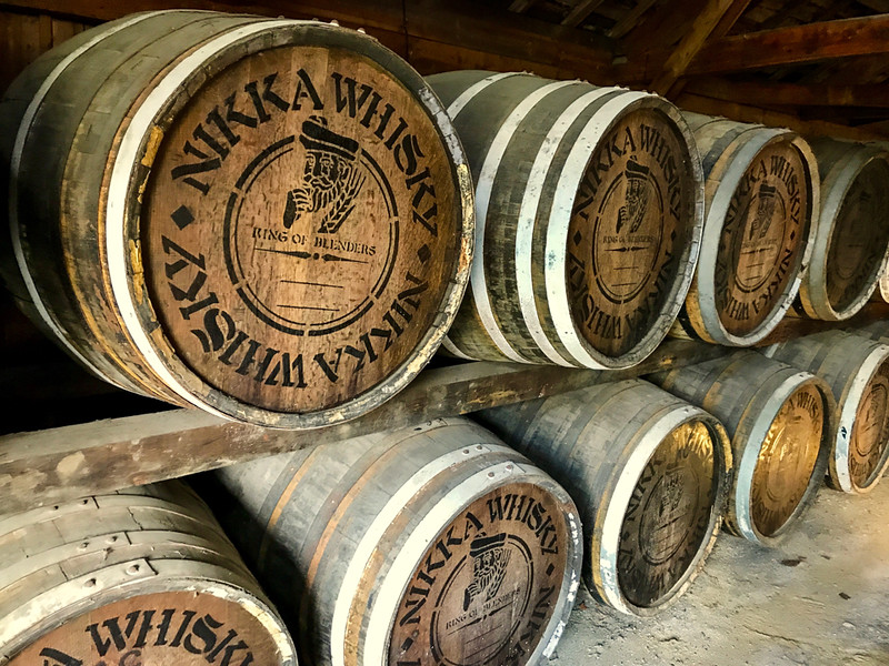 whiskey barrels stacked on top of each other.