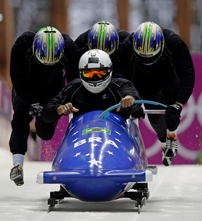 . The team from Brazil BRA-1, piloted by Edson Bindilatti, start a run during the men\'s four-man bobsled training at the 2014 Winter Olympics, Friday, Feb. 21, 2014, in Krasnaya Polyana, Russia. (AP Photo/Dita Alangkara)