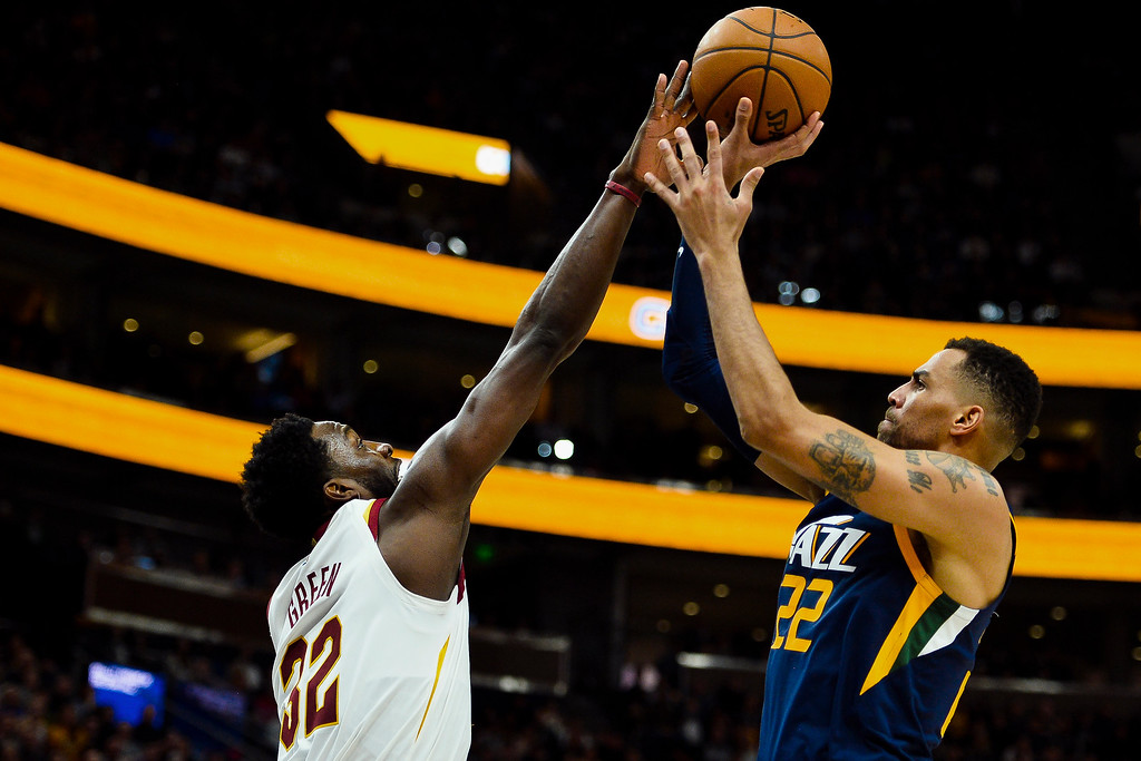 . Cleveland Cavaliers forward Jeff Green (32) blocks Utah Jazz forward Thabo Sefolosha (22) in the second half of an NBA basketball game Saturday, Dec. 30, 2017, in Salt Lake City. (AP Photo/Alex Goodlett)
