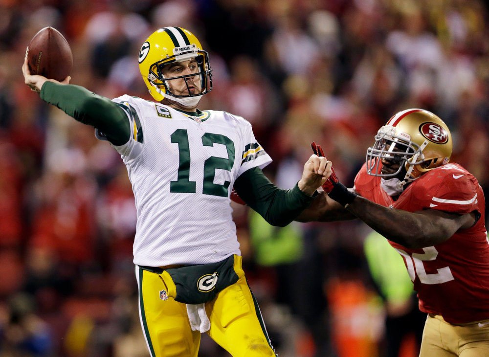 . Green Bay Packers quarterback Aaron Rodgers (12) is pressured by San Francisco 49ers linebacker Patrick Willis (52) during the third quarter of an NFC divisional playoff NFL football game in San Francisco, Saturday, Jan. 12, 2013. (AP Photo/Marcio Jose Sanchez)