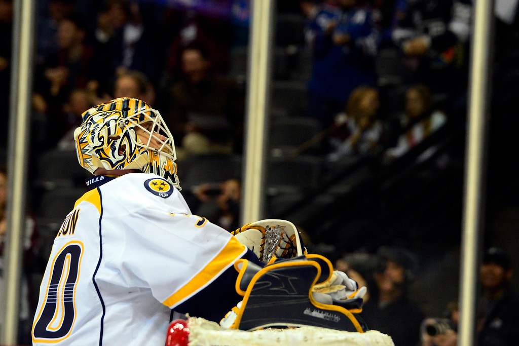 . Chris Mason (30) of the Nashville Predators looks up at the scoreboard after giving a goal up to Aaron Palushaj (17) of the Colorado Avalanche during the first period of action. The Colorado Avalanche take on the Nashville Predators at the Pepsi Center on February 18, 2013. (Photo By AAron Ontiveroz/The Denver Post)