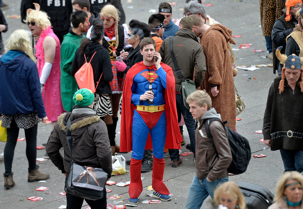 ". A man in a superman costume talks on his cellphone when tens of thousands of revelers dressed in carnival costumes celebrate the start of the street-carnival on the so called ""Old Women\'s Day\"" in the party capital Cologne, Germany, Thursday, Feb. 27, 2014. (AP Photo/Martin Meissner)"