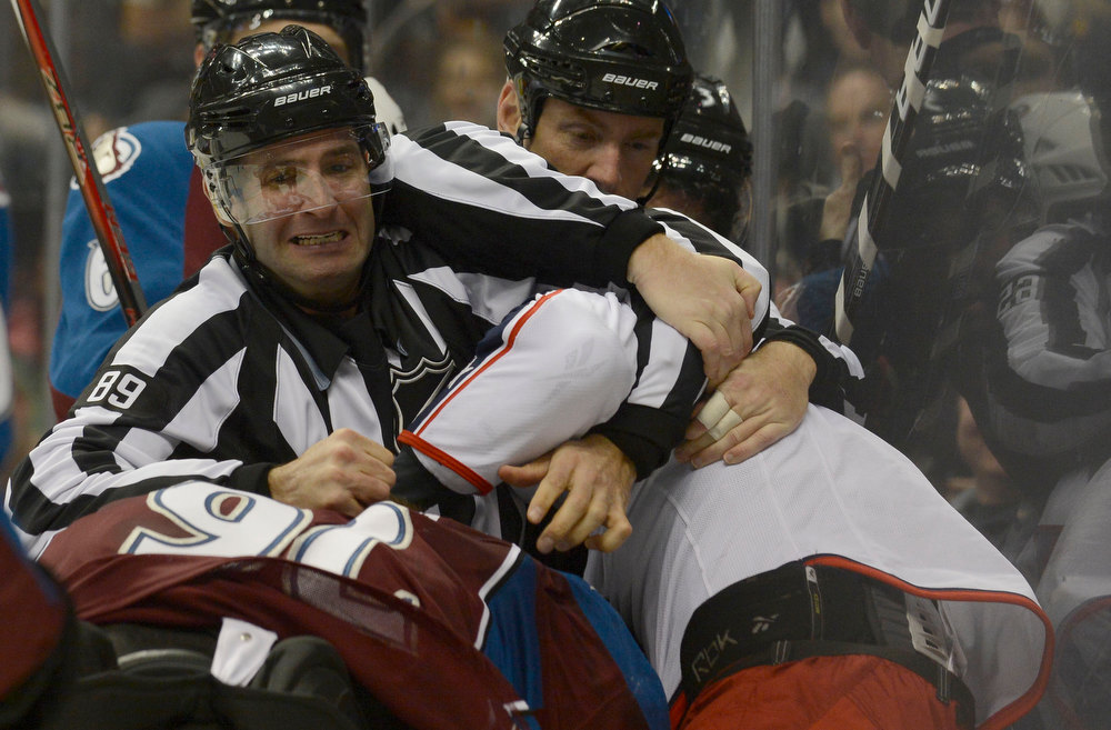 . DENVER, CO. - JANUARY 24: Linesmen Steve Miller (89) and Linesmen Pierre Racicot (65) break up Colorado Avalanche left wing Gabriel Landeskog (92) and Columbus Blue Jackets right wing Derek Dorsett (15) during a scuffle along the boards in the second period January 24, 2013 at Pepsi Center. The Colorado Avalanche take on the Columbus Blue Jackets NHL action. (Photo By John Leyba / The Denver Post)