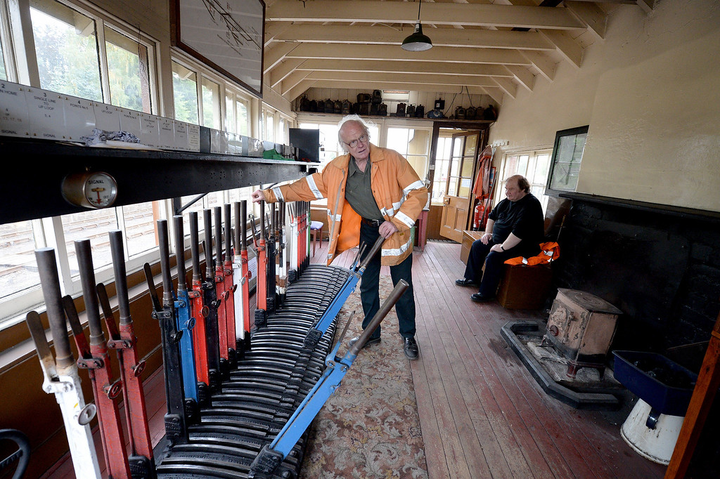 . Signalman Jimmy Summers changes points at Boat of Garten station on the Strathspey Steam Railway on August 27, 2013 in Aviemore, Scotland. (Photo by Jeff J Mitchell/Getty Images)