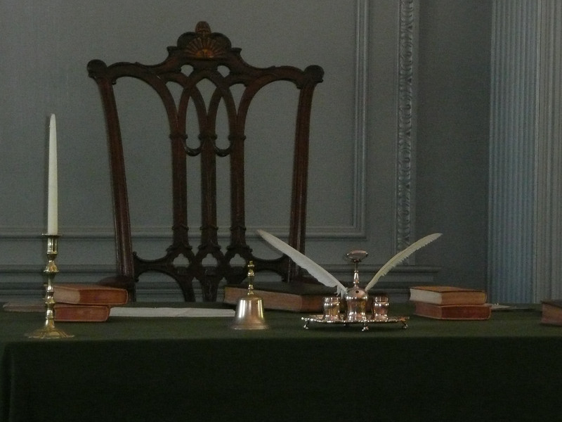 """George Washington's chair (the original).There is a carved """"rising sun"""" on the seatback (can't see it from the photo though)."""