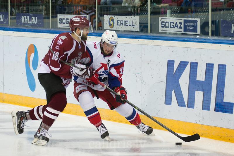 Steven Seigo (16) of Dinamo Riga tries to stop Andrei Loktionov (95)