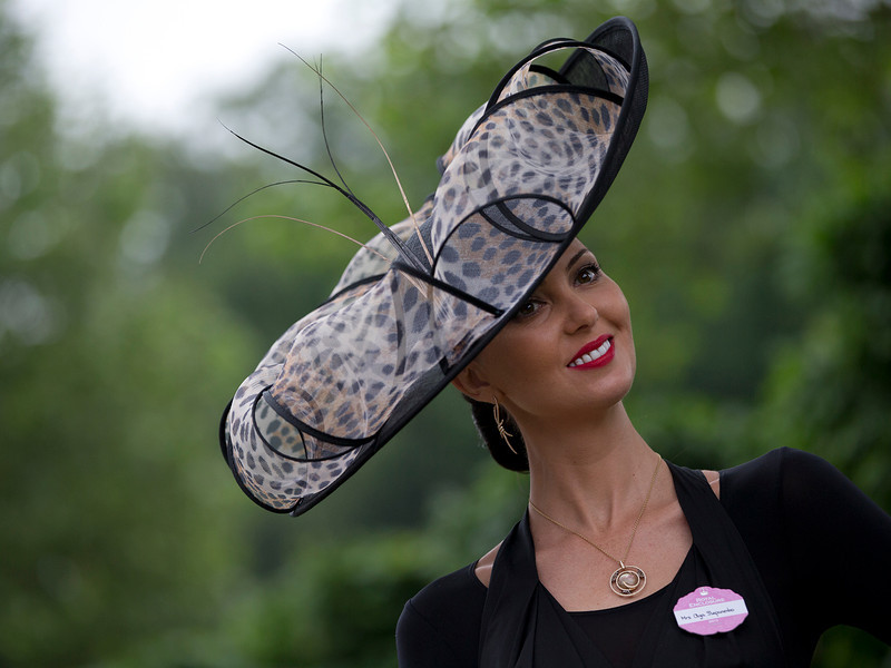 . Olga Stepaneto wears an ornate hat on the third day traditionally known as Ladies Day of the Royal Ascot horse race meeting in Ascot, England, Thursday, June 20, 2013. (AP Photo/Alastair Grant)