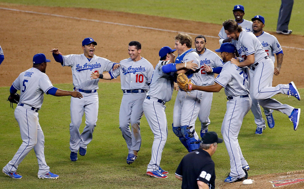 . Los Angeles Dodgers celebrate their win to capture the Western Division National League Championship after a baseball game against the Arizona Diamondbacks, Thursday, Sept. 19, 2013, in Phoenix. The Dodgers won 7-6. (AP Photo/Ross D. Franklin)
