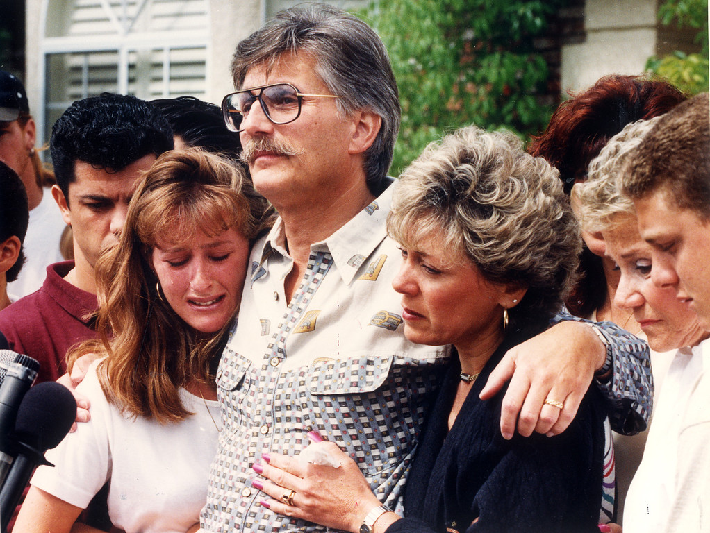 . Ronald Goldman\'s father, Fred, speaks about his son\'s life during a news conference. Ronald Goldman\'s sister, Kim, left, and his stepmother, Patti, embrace Fred Goldman.   (6/15/94)   (Los Angeles Daily News file photo)