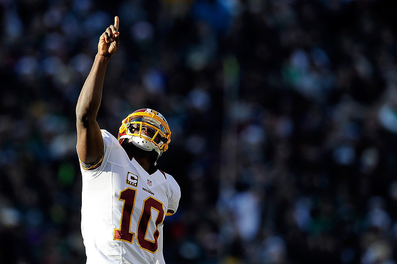 . Robert Griffin III #10 of the Washington Redskins celebrates after Josh Morgan #15 scored a touchdown against the Philadelphia Eagles during the first half at Lincoln Financial Field on December 23, 2012 in Philadelphia, Pennsylvania. (Photo by Patrick McDermott/Getty Images)