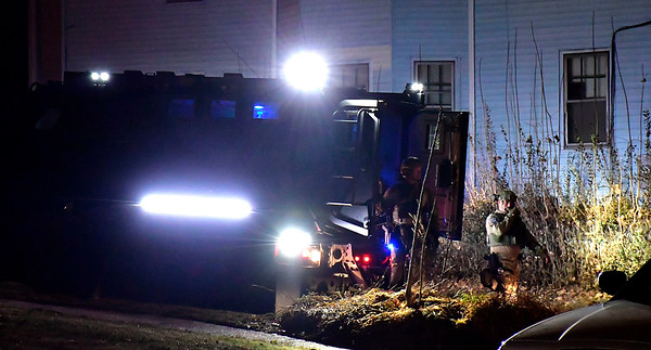 12/12/2018 Mike Orazzi | Staff New Britain and Plainville Police while responding to an incident on Allen Street in the city where a suspect suspect barricaded himself inside a building Wednesday night.