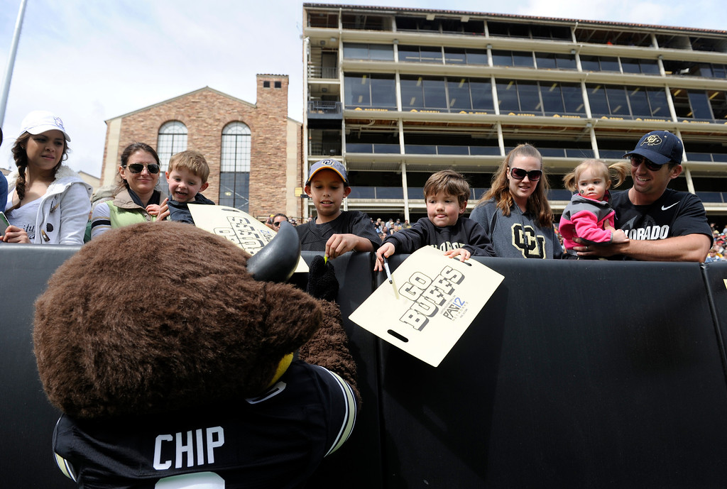 ". BOULDER, CO.- APRIL13: ""Chip\"" signs a few autographs for the fans. The University of Colorado football team hosts its spring football game at Folsom Field under the direction of new head coach Mike Macintyre. (Photo By Kathryn Scott Osler/The Denver Post)"
