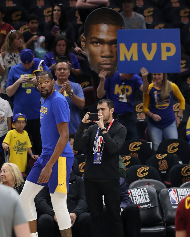 . Fans cheer for Golden State Warriors forward Kevin Durant (35) as he warms up for Game 4 of basketball\'s NBA Finals between the Warriors and the Cleveland Cavaliers, Friday, June 8, 2018, in Cleveland. (AP Photo/Carlos Osorio)