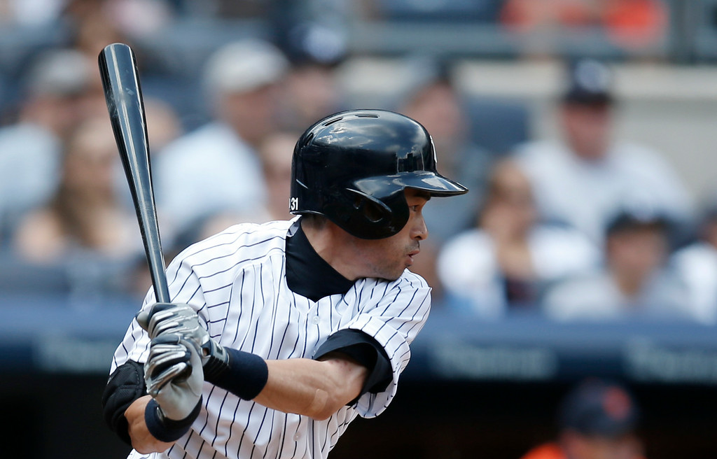 . New York Yankees Ichiro Suzuki hits a third-inning single in a baseball game against the Detroit Tigers at Yankee Stadium in New York, Thursday, Aug. 7, 2014.  (AP Photo/Kathy Willens)