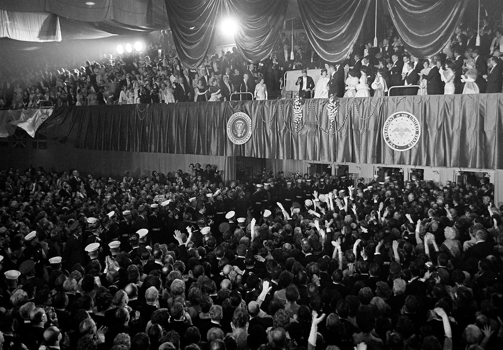 . President John F. Kennedy acknowledges the crowd at the Inaugural Ball at the Washington Armory, Jan. 24, 1961. (AP Photo)