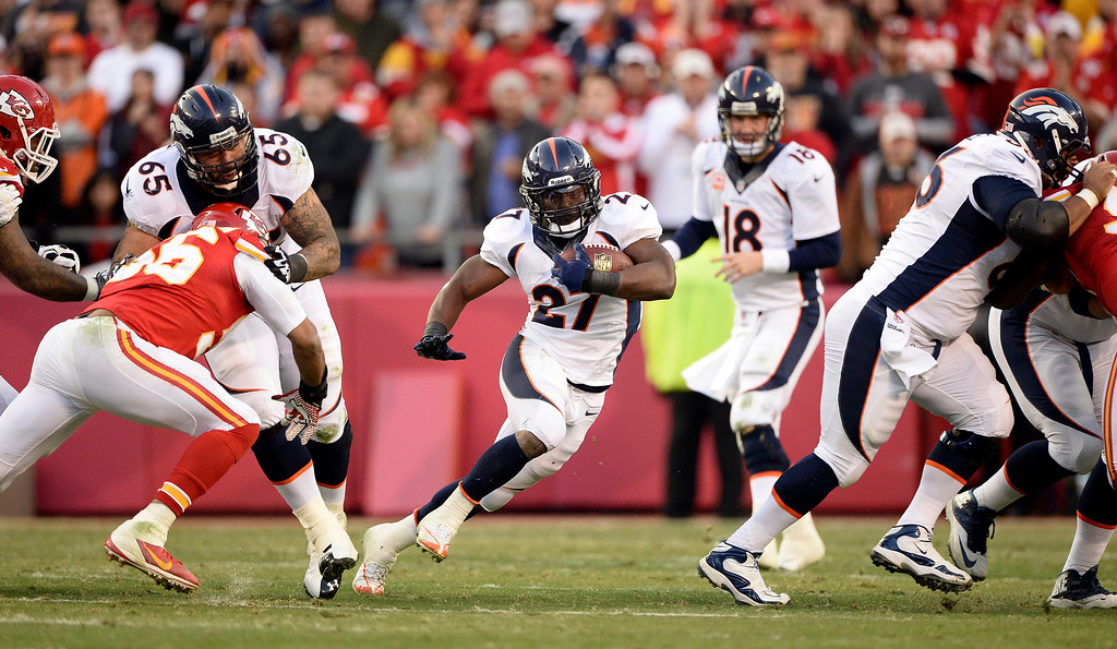 . Denver Broncos running back Knowshon Moreno (27) finds a hole in the Kansas City Chiefs defense during the second quarter December 1, 2013 at Arrowhead Stadium.  (Photo by John Leyba/The Denver Post)