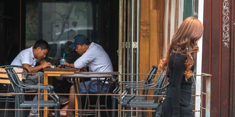 Two men sitting in restaurant, Seoul, South Korea