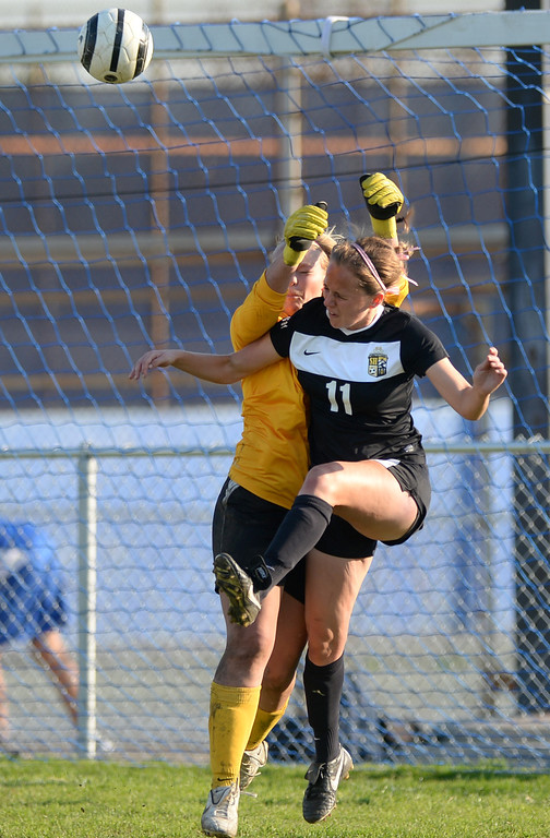 . La Habra goal keeper Katelyn Phinney collides with Sunny Hills\' Sarah Fajnor (#11) in their girls soccer game at La Habra High School on Thursday January 16, 2014. Sunny Hills defeated La Habra 2-0. (Staff Photo by Keith Durflinger/San Gabriel Valley Tribune)