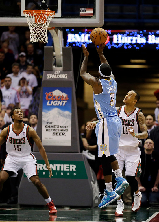 . Denver Nuggets\' Ty Lawson (3)  takes the winning shot as Milwaukee Bucks\' Ish Smith (15) and Monta Ellis(11) watch during the second half of an NBA basketball game, Monday, April 15, 2013, in Milwaukee. Denver won 112-111. (AP Photo/Jeffrey Phelps)