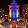 Oakland City Hall Exterior - Blue and Gold LED Lights - Friday, April 18, 2014 at 9:00 PM. Created from one vertical row of 4 overlapping horizontal exposures, 20 seconds each at f/11, ISO 50, 50mm. Digitally stitched for a total of 5535x7749 pixels/300dpi.