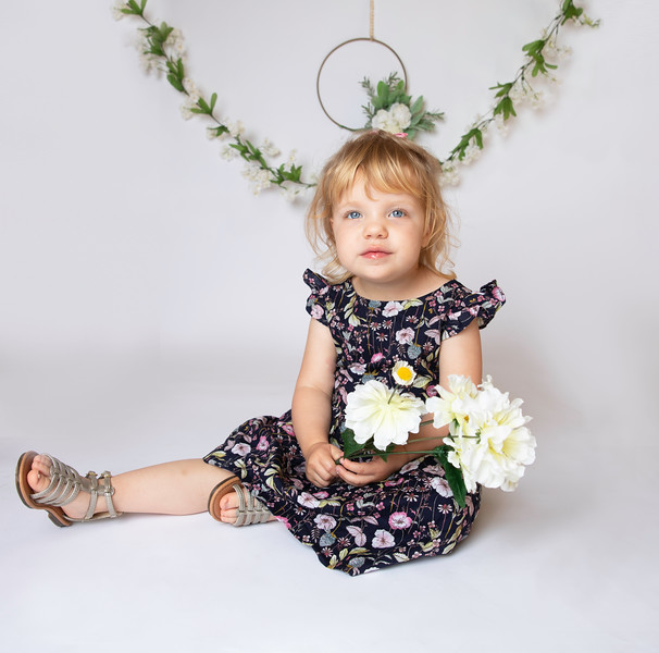 Addyseriouswithflowers.jpg