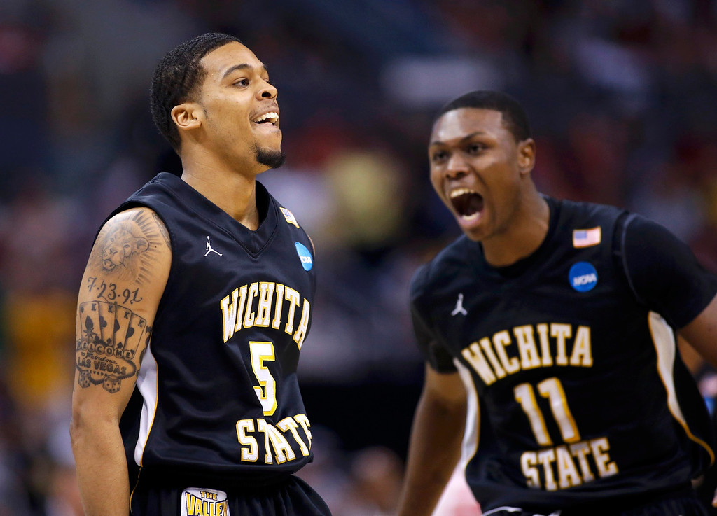 . Wichita State Shockers guard Demetric Williams (5) celebrates his three-point shot against the Ohio State Buckeyes with teammate Cleanthony Early (11) in the first half during their West Regional NCAA men\'s basketball game in Los Angeles, California March 30, 2013. REUTERS/Danny Moloshok