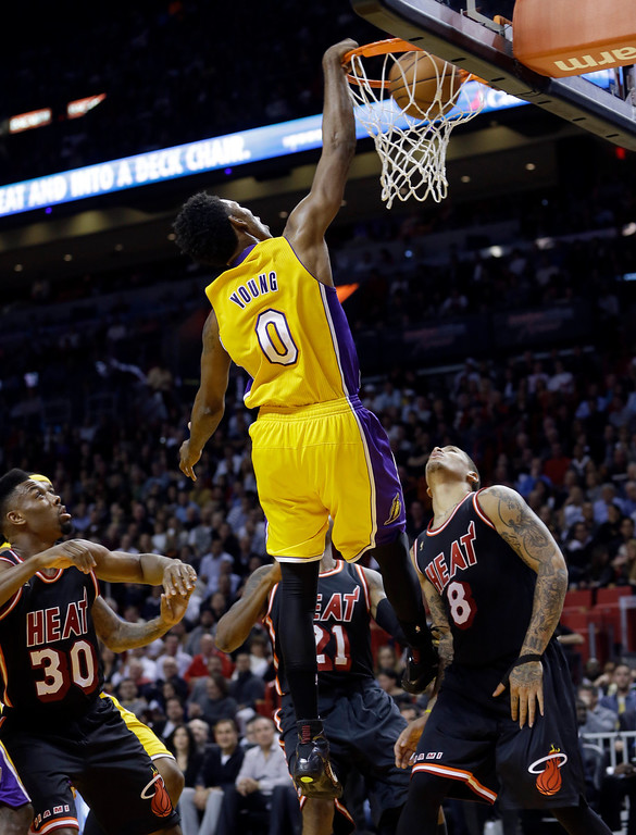 . Los Angeles Lakers forward Nick Young (0) scores against the Miami Heat  during the third quarter of an NBA basketball game in Miami, Thursday, Jan. 23, 2014. The Heat won 109-102. (AP Photo/Alan Diaz)