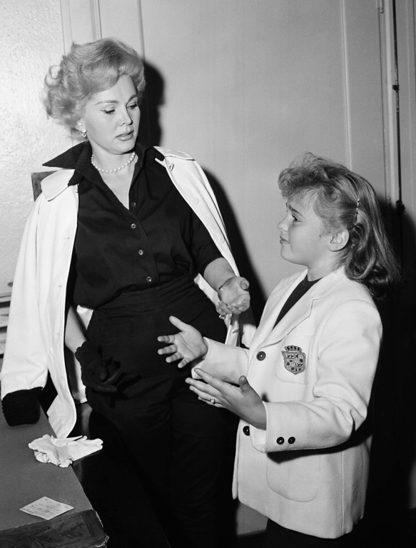 ". Zsa Zsa Gabor supervises the scene as her nine year old daughter, Francesca, demonstrates her dramatic ability at the suggestion of photographers as the girl applied for a union card, in Hollywood on May. 27, 1957, for television work.  Gabor, experienced in posing for newspaper photographs, thought the scene a bit too hammy, and told the girl to cut it out.  Francesca is scheduled to make her acting debut May 30, 1957 on TV\'s ""Playhouse 90.\""    (AP Photo/Harold Filan)"