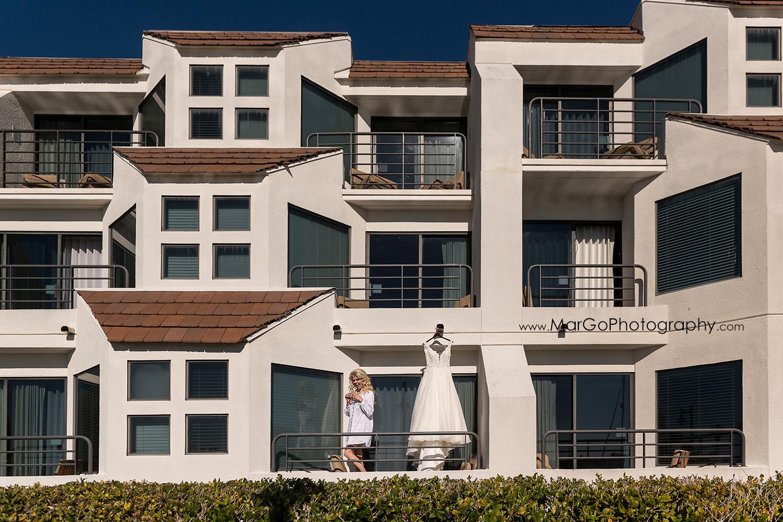 bride and wedding dress on the balcony at San Diego Hyatt Regency Mission Bay Hotel