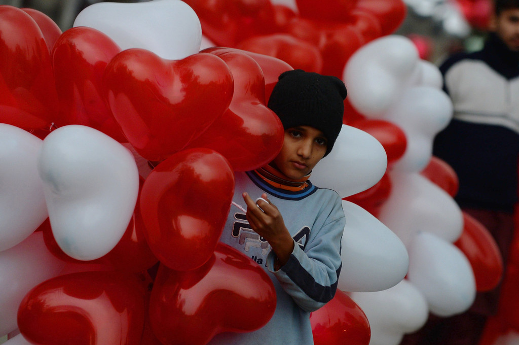 . A Pakistani boy sells heart-shaped balloons on a street in Lahore on February 14, 2014. At least three students were wounded in a clash at a university in the northwestern Pakistani city of Peshawar, following a dispute over Valentine\'s Day celebrations in the deeply Muslim country, police said. AFP PHOTO/Arif ALIArif Ali/AFP/Getty Images