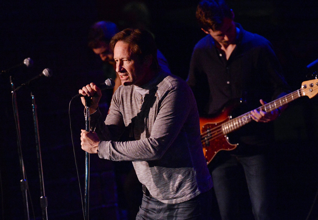 """. Actor and singer David Duchovny performs at The Cutting Room, to promote his debut album \""""Hell Or Highwater\"""", on Tuesday, May 12, 2015, in New York. (Photo by Evan Agostini/Invision/AP)"""