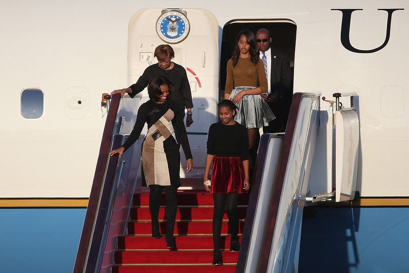 . First Lady Michelle Obama with her mother Marian Robinson, daughters Sasha Obama and Malia Obama arrives at Beijing Capital International Airport on March 20, 2014 in Beijing, China. The first lady arrived in Beijing with her mother, Marian Robinson, and daughters to kick off a six-day tour where she will focus on education and cultural exchange. (Photo by Feng Li/Getty Images)