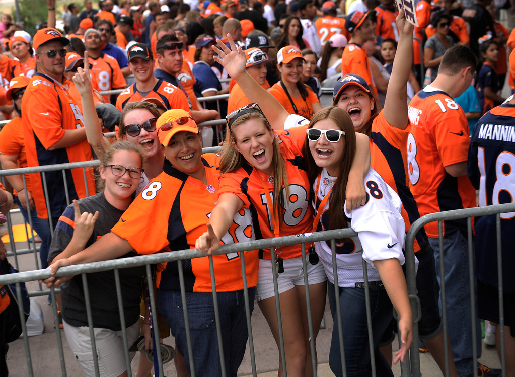 . DENVER, CO. - AUGUST 03: Broncos fans, from left, Charlotte Wolsleben, Grace Diamond, Toni Segura, Annie Bingham, Casandra Segura, and Stephanie Segura showed their excitement even before the gates opened Saturday. Denver Broncos fans lined up outside Sports Authority Field Saturday afternoon, August 3, 2013 before gates opened to watch practice.  Photo By Karl Gehring/The Denver Post