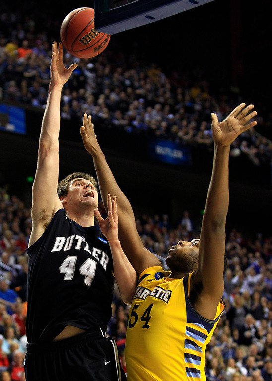 . Butler center Andrew Smith (44) shoots as Marquette forward Davante Gardner (54) defends in the first half of a third-round NCAA college basketball tournament game on Saturday, March 23, 2013, in Lexington, Ky. (AP Photo/James Crisp)