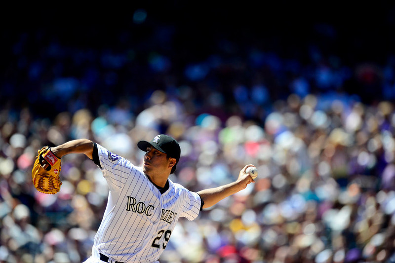 . Colorado Rockies starting pitcher Jorge De La Rosa (29) fires a pitch against the Los Angeles Dodgers during second inning action in Denver. The Colorado Rockies hosted the Los Angeles Dodgers at Coors Field. (Photo by AAron Ontiveroz/The Denver Post)