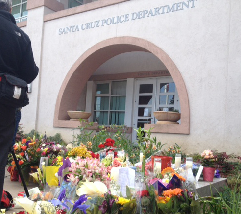 ". A memorial of flowers and candles sits outside the Santa Cruz Police Department in Santa Cruz, Calif., the day following shootings that took the lives of <a href=""http://www.santacruzsentinel.com/localnews/ci_22676928/loran-butch-baker-28-year-veteran-leaves-legacy\"">Sgt. Loran \""Butch\"" Baker</a> and detective <a href=\""http://www.santacruzsentinel.com/localnews/ci_22676931/santa-cruz-police-detective-elizabeth-butler-policing-was\"">Elizabeth Butler</a> in front of the police department in Santa Cruz, Calif. on Wednesday, Feb. 27, 2013. The pair were <a href=\""http://www.santacruzsentinel.com/localnews/ci_22674808/breaking-2-officers-1-suspect-shot-santa-cruz\"">gunned down yesterday</a. (Stephen Baxter/Sentinel)"