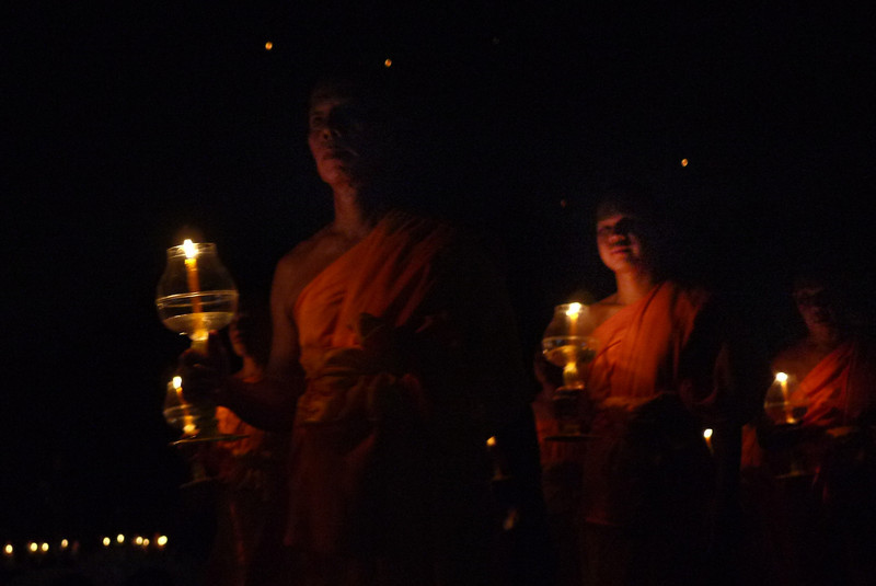 Monks and candlelight during Loy Krathong in Chiang Mai, Thailand