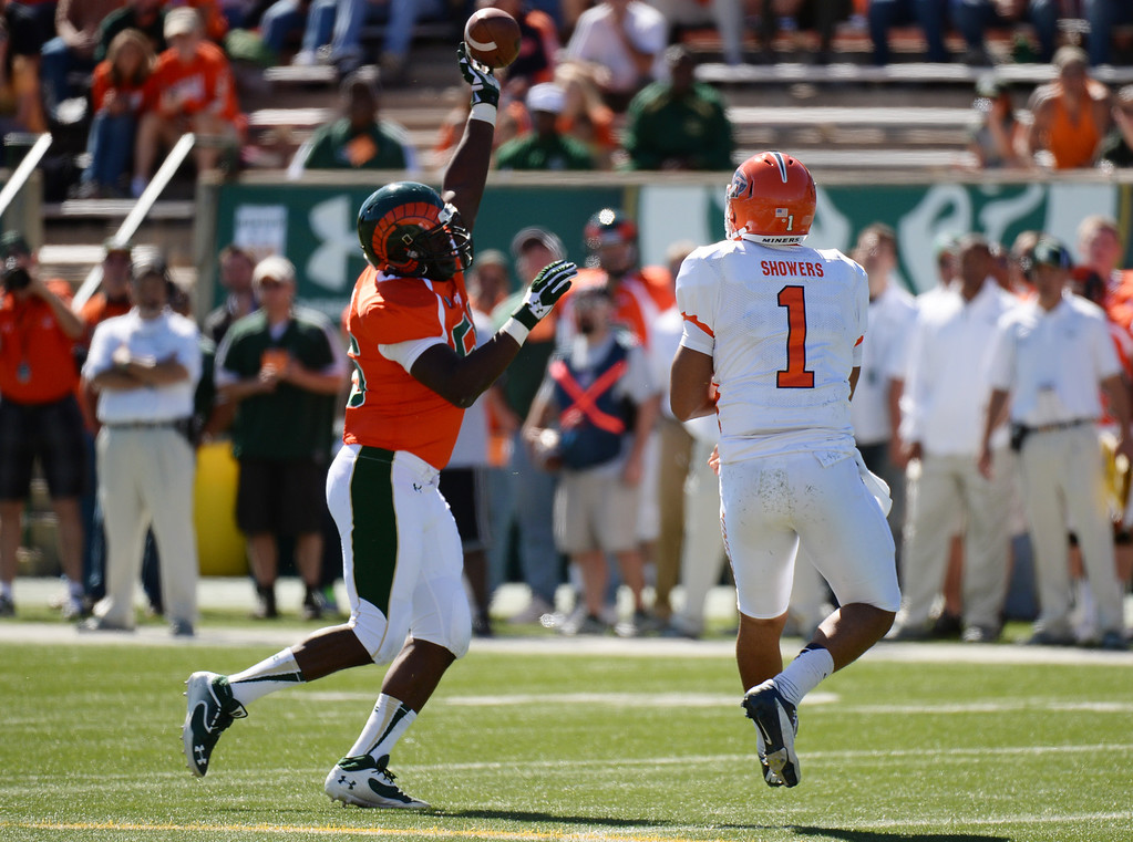. FORT COLLINS, CO - September 28 : Shaquil Barrett of Colorado State University (56), left, blocks the pass thrown by QB Jameill Showers of University of Texas at El Paso (1) in the 1st half of the game at Hughes Stadium. Fort Collins, Colorado. September 28, 2013. (Photo by Hyoung Chang/The Denver Post)