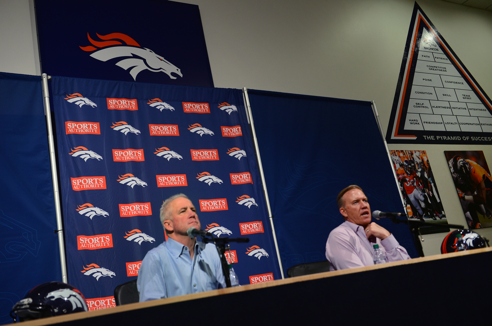 . Denver Broncos head coach John Fox, left, and John Elway, Executive Vice President of Football Operations talk to members of the media at Dove Valley in Englewood, Co on February 4, 2014.  The two held a press conference to talk about the team\'s loss in the Super Bowl to the Seattle Seahawks.  (Photo By Helen H. Richardson/ The Denver Post)