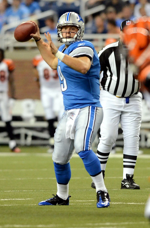 . Detroit Lions QB Matthew Stafford delivers a pass during their preseason game against the Cincinnati Bengals at Ford Field, Friday August 12, 2011. (Oakland Press Photo By: Vaughn Gurganian)