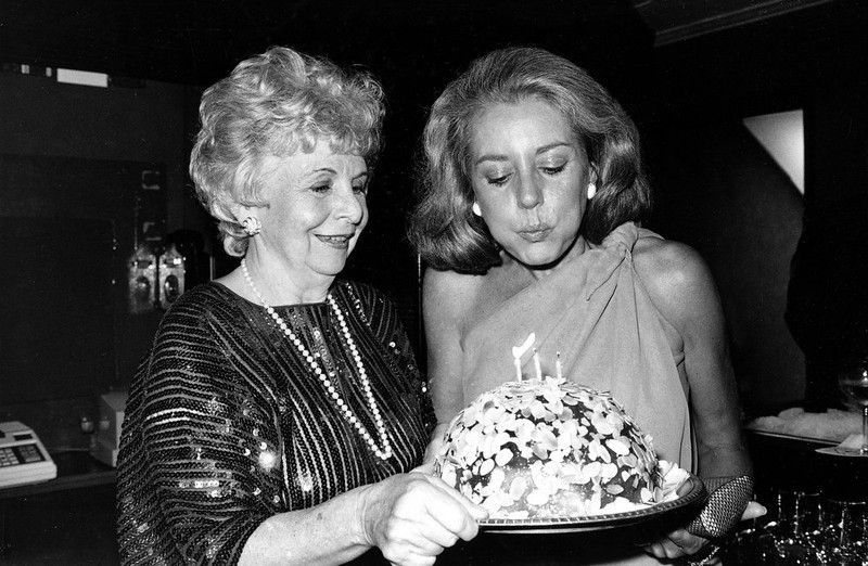 . ABC\'s television news anchorwoman Barbara Walters, right, blows out the candles on an apricot cake during a party celebrating her 46th birthday, at a midtown Manhattan restaurant in New York, September 26, 1977. Holding the cake is Lenore Hershey, editor of the Ladies\' Home Journal. (AP Photo/Carlos Rene Perez)