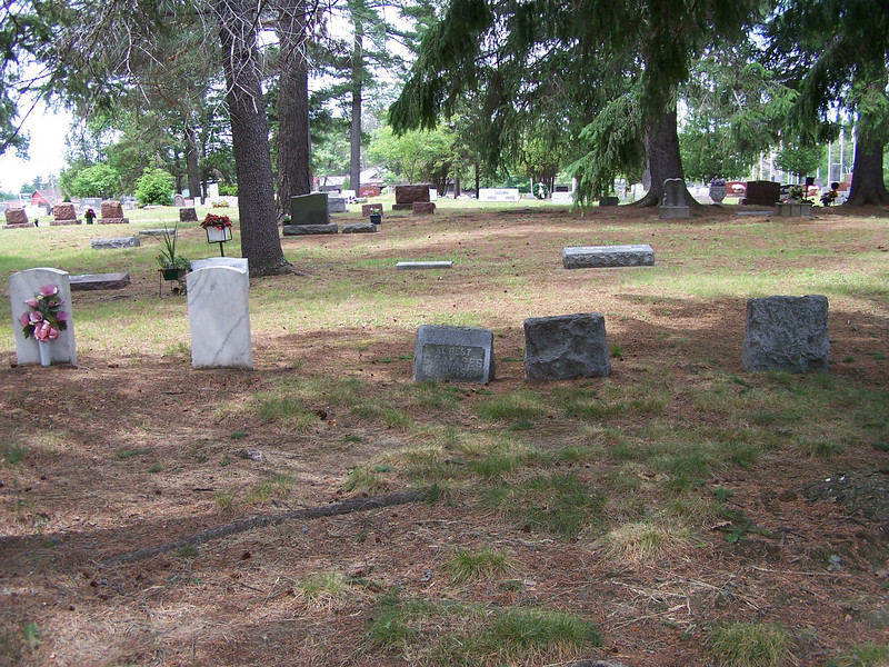 C.F. Mapes' grave at Evergreen Cemetery. His headstone in in the middle of this Mapes family group, the only one facing the road- the other four are facing the other direction. This is facing west, toward Hwy. 51 going through Minocqua and Woodruff.